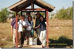 Our group posing with the well and pump donated by our friends and clients from previous trips