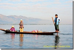 """Intha Style"" boats are family cars for the villagers living on Inle Lake. Here the father takes his daughter to school and his wife to market before beginning his day fishing."