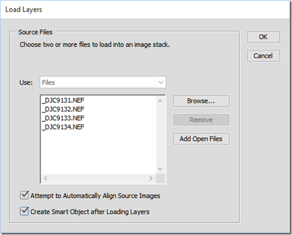 With Photoshop CC you can create a layer stack, align the layers, and create a smart object all in one step